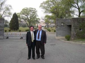 In front of the State Guest House in Pyongyang with one of the  North Korean hosts and Secretary General Paolo Cotta-Ramusino