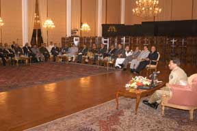President Musharraf addresses the workshop participants