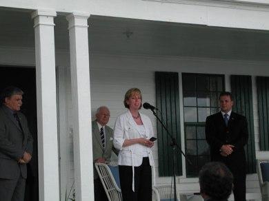 Sandra Ionno Butcher helping present Joseph Rotblat's Nobel Peace Prize Medallion to Thinker's Lodge